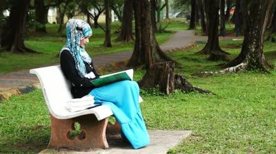 stockfootage-beautiful-muslim-lady-checking-her-notebook