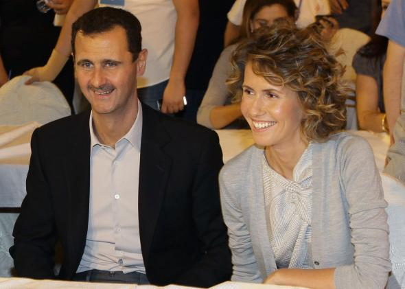 110786893-syrian-president-bashar-assad-and-his-wife-asma-visit-a.jpg.CROP.promo-mediumlarge