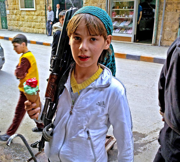 9.-The-Boy-Juggling-Ice-Cream-Cone-and-Automatic-Rifle1