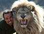 Man attempts to hug wild lion (Video)