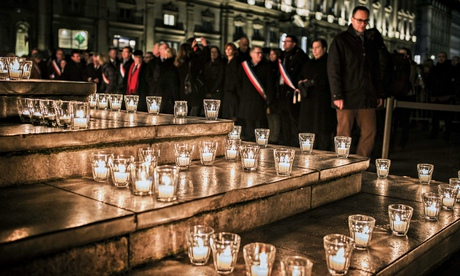 Candles are displayed during a gathering